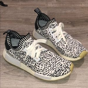 Men's Adidas NMD shoes.